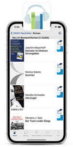 iPhone with running Hörbücherei App. The DAISY catalog overview is displayed on the screen. The logo of the audio library app is at the top.